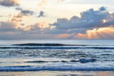 The sun sets over the sea, a beautiful sunset with clouds and waves in the sea. - 249743755