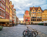 Colourful houses in the old town of Wroclaw, Poland near flower market and Market Square, a bicycle in the foreground, copy space.