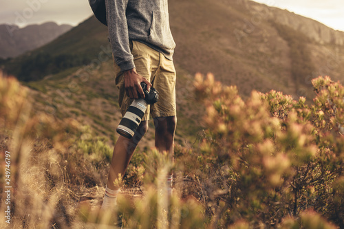 Photographer hiking in nature © Jacob Lund