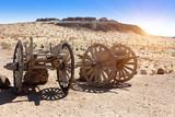 An old wooden cart on two wagon wheels in the Kyzyl Kum desert, Uzbekistan - 249747588