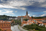 Cesky Krumlov castle and ancient historical houses and sky with stormy clouds, Czech Republic