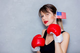 Young woman in boxing gloves with USA flag