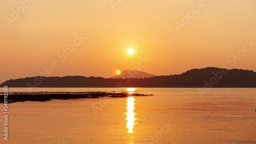 4k Timelapse of beautiful light sunrise scenery or sunset sky with reflection over sea and clouds flowing in the sky