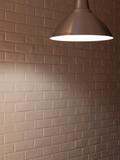 brick wall and three ceiling lamp. warm light yellow