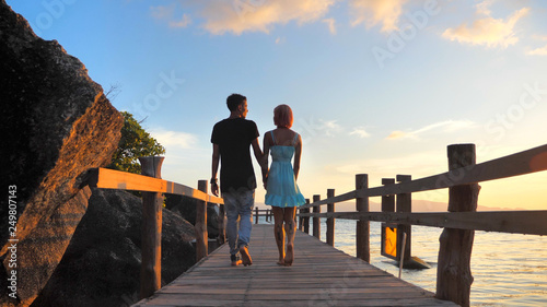 Beautiful Young Couple in Love spend time Together at Sunset time with Sea view - 249807143