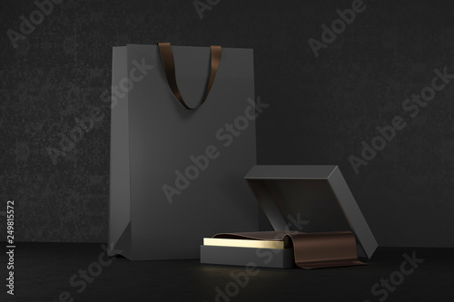 Premium black package for purchases on a black background. Black paper shopping bag with handles Mock Up. Luxury bag and box, 3d rendering.