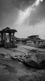 little stone temple with dramatic mystic sky in hampi india karnakata black and white