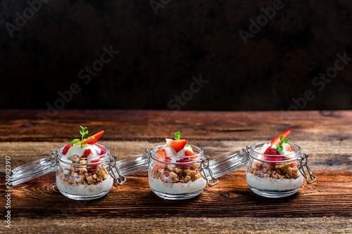 Leinwandbild Motiv Delicious home-made muesli with yoghurt and fresh berries, beautifully presented in a mason jar to take away on the go