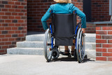 woman on wheelchair and stairs - 249827321