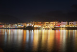 Night view of Hersonissos. Reflection of city lighting in the water.