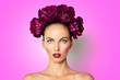 Leinwanddruck Bild - Beauty Sexy Model girl with peony flowers wreath. Beautiful brunette young woman perfect make-up, red seductive lips. Trendy makeup, beauty spa skin concept pink background