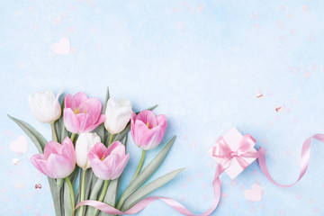 Tulip flowers and gift box for Women day, Mother day background. Flat lay.