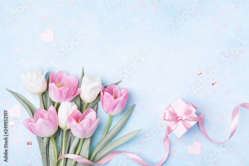 Tulip flowers and gift box for Women day, Mother day background. Flat lay. © juliasudnitskaya