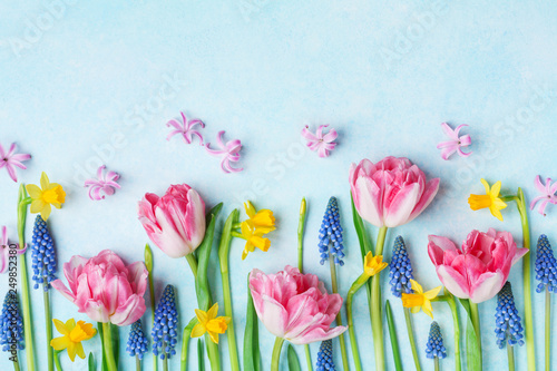 Creative composition of beautiful spring flowers on pastel table top view. Greeting card for International Women Day. Flat lay. - 249852380