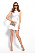 Quadro Young fashion woman in white dress and sunglasses.