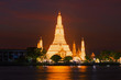 Quadro Big prang Buddhist temple Wat Arun in night lighting in the evening twilight . Bangkok, Thailand