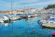 Leinwanddruck Bild - Many boats in harbor and old town Piran, Slovenia