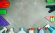 Cleaning products on the tile. House cleaning concept. View from above. Place for a logo lettering