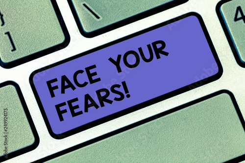 Handwriting text Face Your Fears. Concept meaning Have the courage to overcome anxiety be brave fearless Keyboard key Intention to create computer message pressing keypad idea