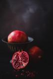 Still life of pomegranates against a dark background