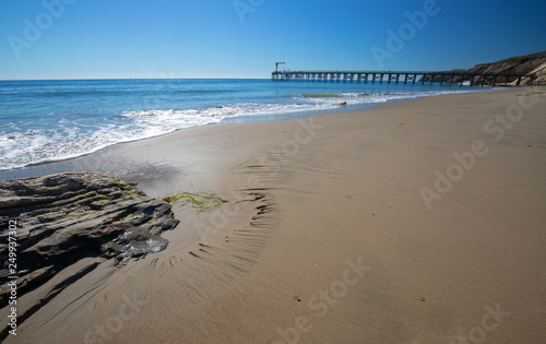 Fishing Pier and boat hoist at Gaviota Beach State Park on the central coast of California United States © htrnr