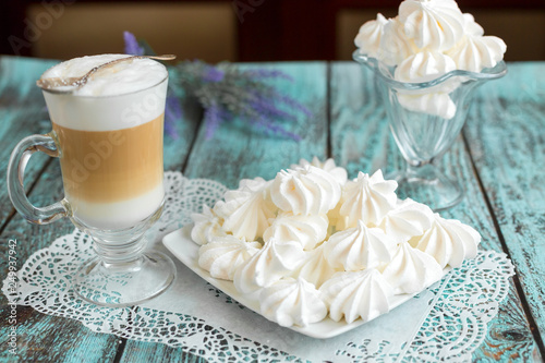 White marshmallows and bizet with coffee latte on the table in cafe. Delicious sugar dessert. Food photo concept © Andreshkova Nastya