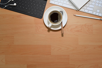 Office wooden desk table with computer, coffee cup and copy space