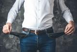 man hand empty pocket on dark background - 249965746