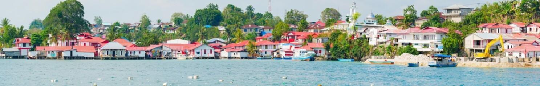 Red and white village at Tual, Kei Kecil island, Moluccas. A colorful slum called Kampung Merah Putih, colors of Indonesia national flag. High resolution panorama. © fabio lamanna