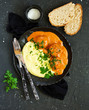 Meatballs in creamy tomato sauce with mashed potatoes. - 249988315