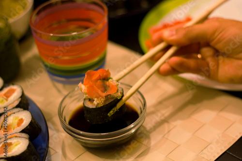 Japanese food restaurant, sushi maki roll plate, platter set. Hand take roll.