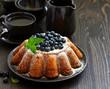 Vanilla cake (gugelhupf) with blueberries. dark background.