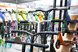 Handlebars of scooters in store