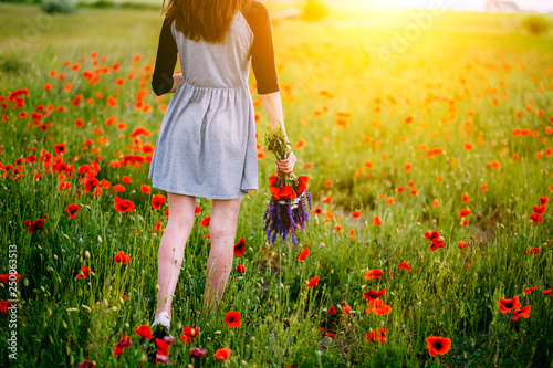 Leinwanddruck Bild Woman with summer flowers