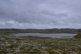 tundra landscape with lake and hills