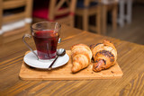 Cup of tea and croissants - 250083745