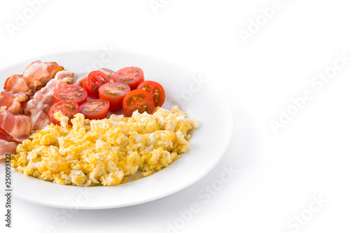 Breakfast with scrambled eggs, bacon and tomatoes isolated on white background. Copyspace - 250093322