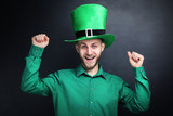 St. Patrick's Day. Young man wearing green hat on black background - 250098930