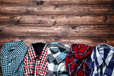 Colorful shirts on brown wooden table