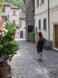 Tourist on a narrow old street in Italy