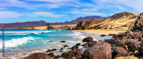 Wild beauty and unspoiled beaches of Fuerteventura. La Pared -popular surfer's spot, Canary islands - 250110955