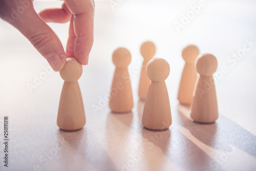 Leinwandbild Motiv Successful team leader, Businesswoman hand choose people standing out from the crowd.