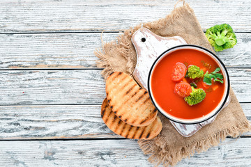 Tomato soup with vegetables and parsley. Mexican soup in a bowl. Top view. © Yaruniv-Studio