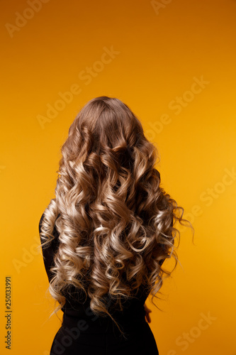 Photo of model with long curly hair