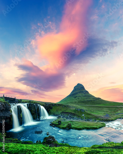 Colorful sunrise on Kirkjufellsfoss waterfall. Amazing morning scene near Kirkjufell volkano, Iceland - 250142982