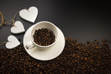 Coffee cup full coffe beans with three white heart
