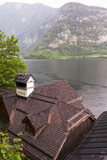 Old vintage wooden roofs of houses by the lake in Hallstatt, Austria
