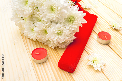 Romantic gift concept. Valentines day or 8th march or love holiday. Present case and flowers. Table setting on wooden background © FuzullHanum