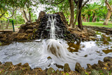 Beautiful man-made waterfall in Macintosh Island park. Surfers Paradise, Queensland, Australia