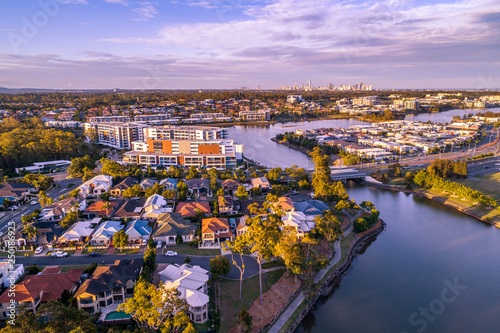 Leinwanddruck Bild Varsity Lakes suburb luxury real estate at sunset. Gold Coast, Queensland, Australia - aerial landscape